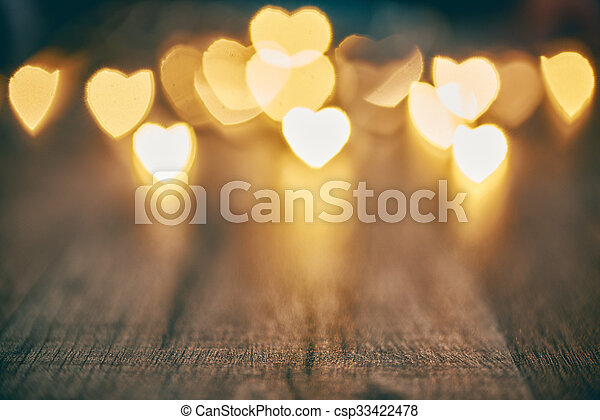 Garland lights on wooden rustic background. Valentine\'s day background with hearts. The concept of love and Valentine\'s day.