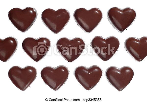 Heart-shaped dark chocolate candies - csp3345355