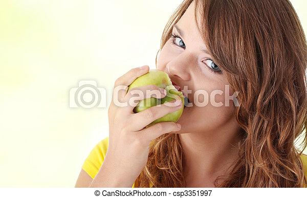 Teen girl eating green apple