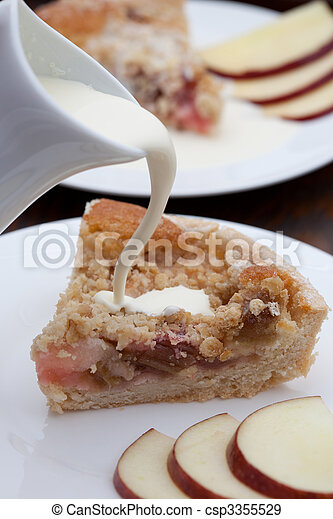 Slice of freshly baked rhubarb crumble - csp3355529