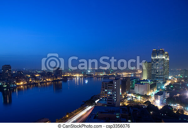Panorama across Cairo skyline at night - csp3356076