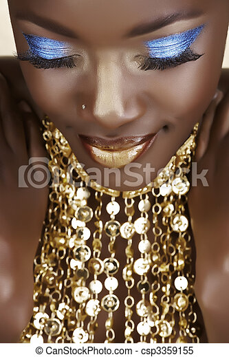 African woman with gold - csp3359155