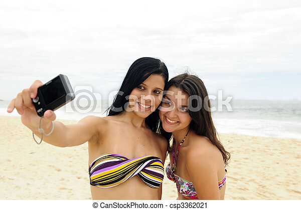 two women taking self-portrait with cellphone - csp3362021