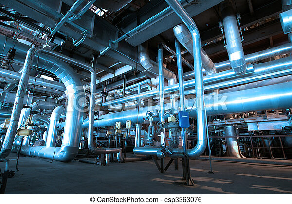 Pipes, tubes, machinery and steam turbine at a power plant - csp3363076