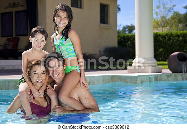 Happy Family With Two Children Playing In A Swimming Pool - csp3369612