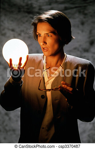 Businesswoman Gazing Into Glowing Ball - csp3370487