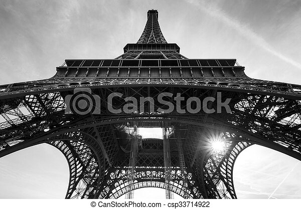 Beautiful view of the Eiffel tower seen from beneath in Paris in black and white