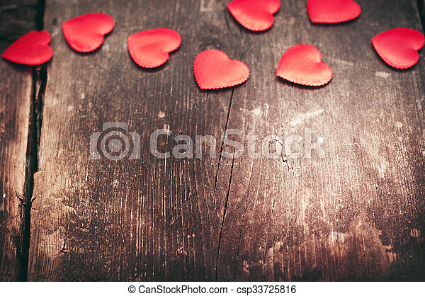 Valentine day. Red hearts on the old dark boards. Valentine\'s Day. Heart pendant. Red heart. Space for text. Eighth of March. International Women\'s Day. Small DOF. Toned image.
