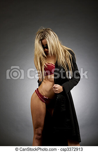woman removing her clothes - csp3372913