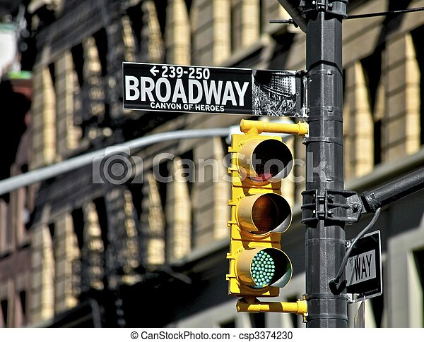 Broadway street sign and traffic light - csp3374230
