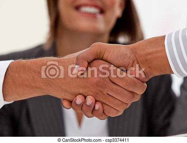 Close-up of successful businessmen closing a deal - csp3374411