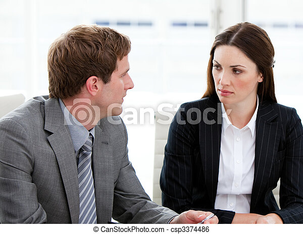 Two concentrated business people talking together - csp3374486