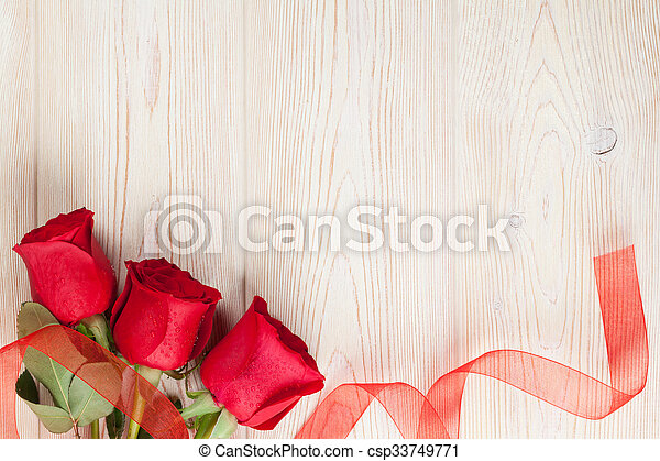 Red roses on wooden background. Valentines day background