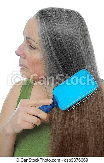 banque de photographies de gris brun cheveux teinture femme peignes elle csp3376669. Black Bedroom Furniture Sets. Home Design Ideas