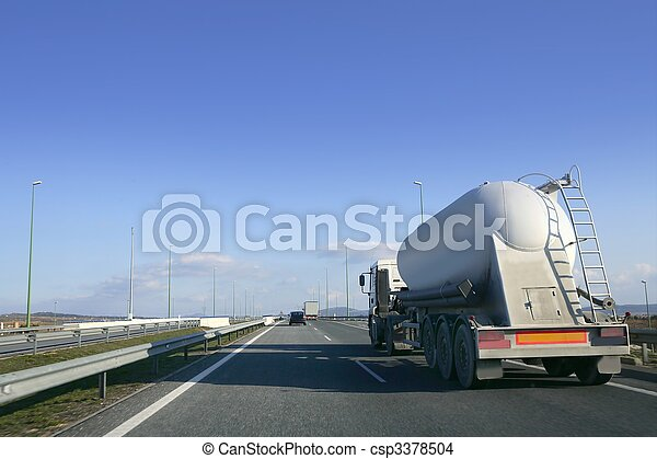 Heavy liquid transportation truck lorry on a road  - csp3378504