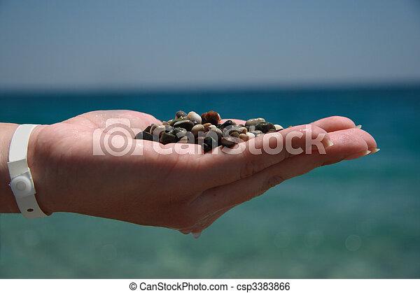 Handful of stones in hand - csp3383866