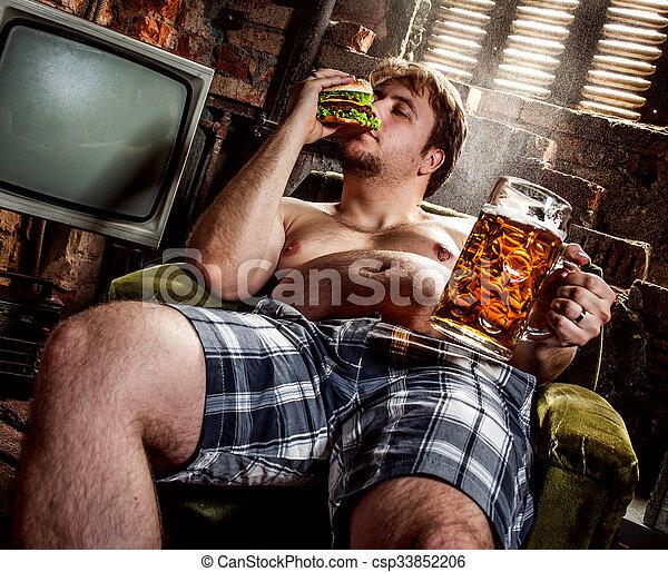 fat man eating hamburger - csp33852206