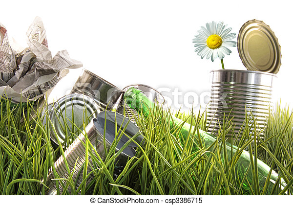 Trash, empty cans and bottles in grass - csp3386715