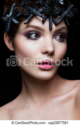 Close-up portrait of beautiful woman with bright make-up - csp33877561