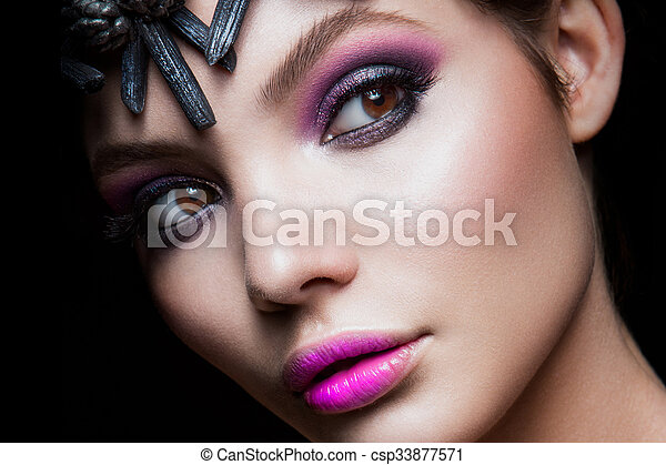 Close-up portrait of beautiful woman with bright make-up - csp33877571