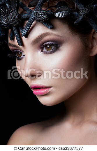 Close-up portrait of beautiful woman with bright make-up - csp33877577