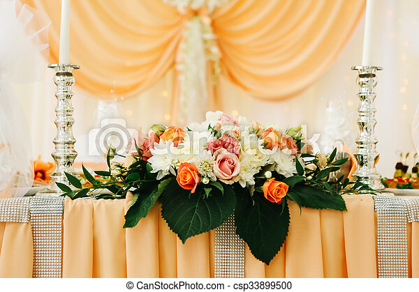 beautiful wedding table decoration decor of the newlyweds in peach tones