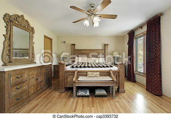 Master bedroom with oak wood furniture - csp3393732