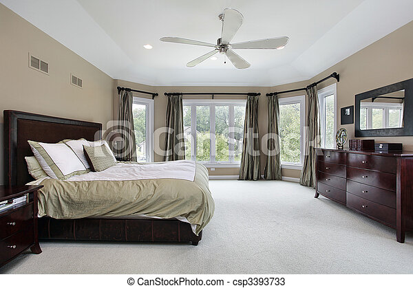 Master bedroom with wall of windows - csp3393733