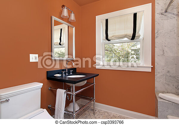 Powder room with orange walls - csp3393766