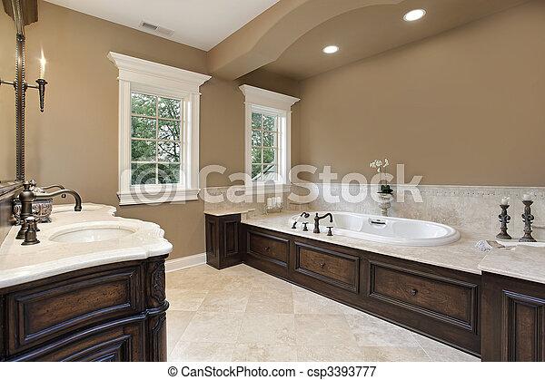 Master bath with dark wood trim - csp3393777
