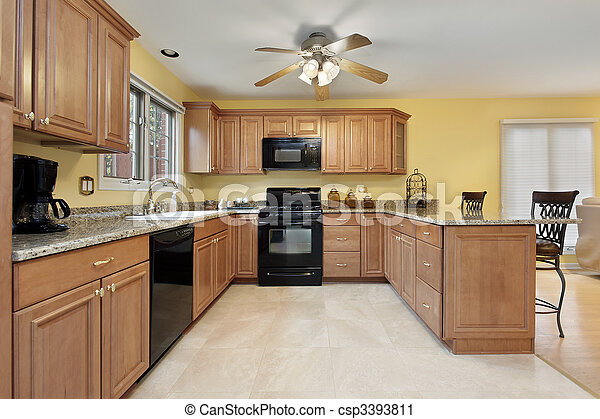Kitchen with black appliances - csp3393811
