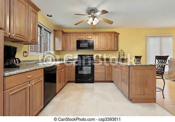 Kitchen with black appliances - csp3393811