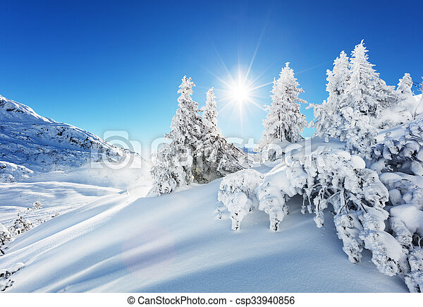 Beautiful winter landscape in the mountains with blue sky and shinning sun