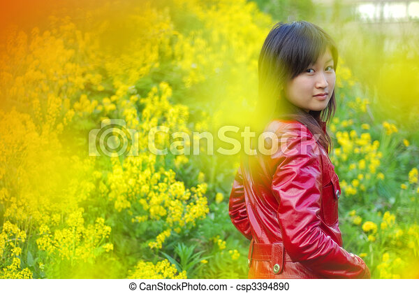 Beautiful asian girl in red outdoors - csp3394890