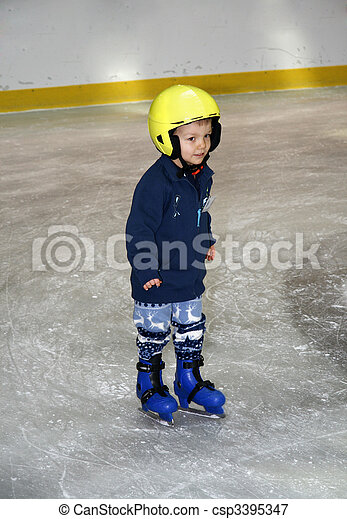Young boy learning to skate - csp3395347