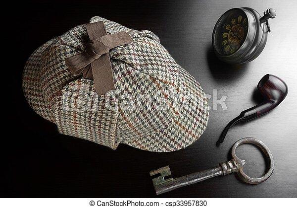 Sherlock Deerstalker Hat,  Key, Clock,Smoking Pipe On Black Table - csp33957830