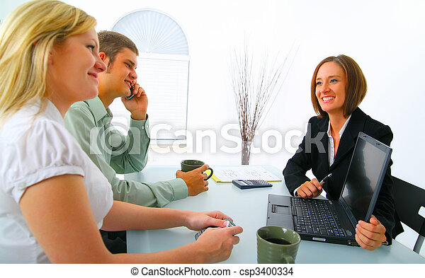 Real Estate Broker Showing Laptop To Potential Clients