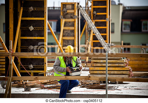 Construction worker working on a construction site. Preparation for Euro 2012 football championship.