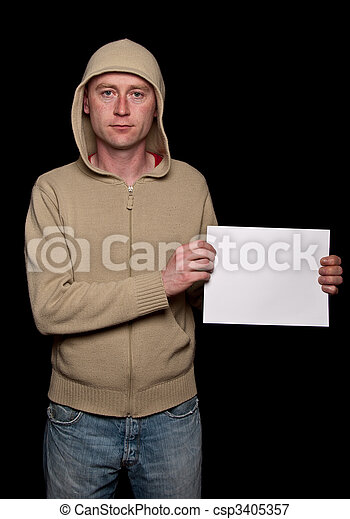 male in a hoodie holding blank advert space - csp3405357