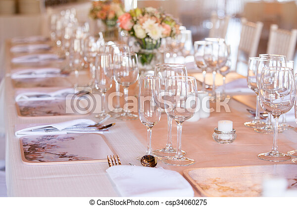 Champaigne and wine glasses on table at wedding reception - csp34060275