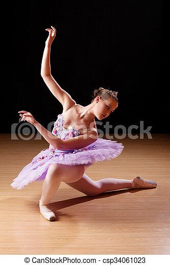 Teenage girl performing ballet in studio - csp34061023