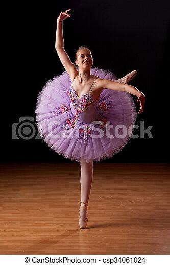 Young ballerina in studio practising - csp34061024