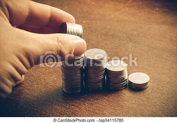 money concept coins baht thai and hand with filter effect retro vintage style