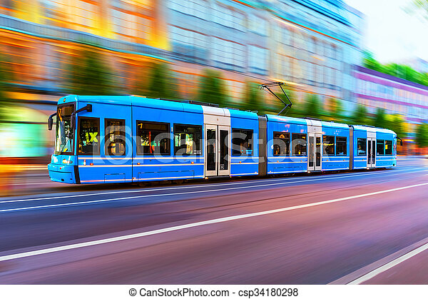 Creative abstract city transportation and business travel technology industrial concept: blue modern tram on urban city street with motion blur effect in Stockholm, Sweden