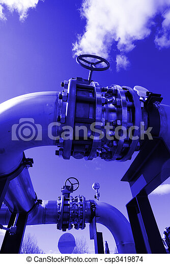 Pipes, bolts, valves against blue sky in blue tone   - csp3419874