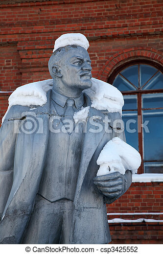 Neglected monument of Vladimir Lenin at winter - csp3425552