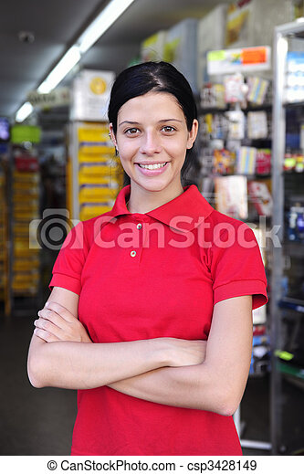 teenage girl working part time in a stationery shop - csp3428149