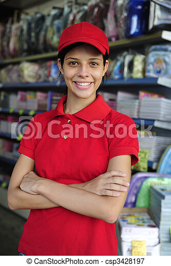 teenage girl working part time in a stationery shop - csp3428197