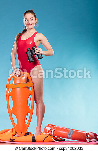 Lifeguard with rescue tube buoy. Woman supervising swimming pool water with binoculars. Accident prevention and rescue.