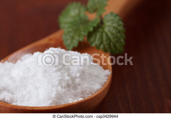 Icing sugar in a wooden spoon - csp3429944
